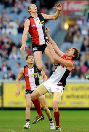Up, up and away: St Kilda's Ben McEvoy soars over Demon Jake Spencer at the MCG on Saturday.