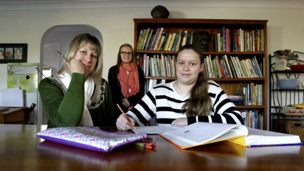 Linda Richardson home schools daughter Jasmine Richardson, 13, (right) who is currently in grade 9, at their home in ...