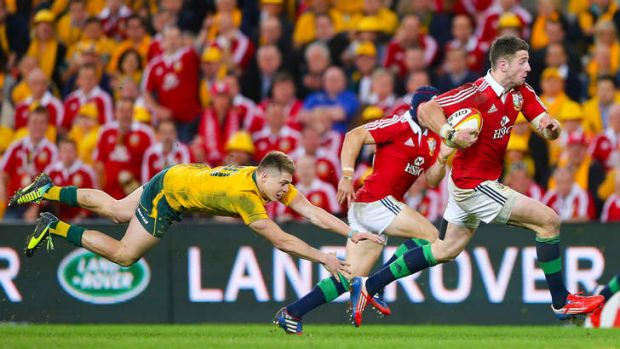 Clean pair of heels: James O'Connor's despairing dive fails to stop Lion Alex Cuthbert at Suncorp Stadium.