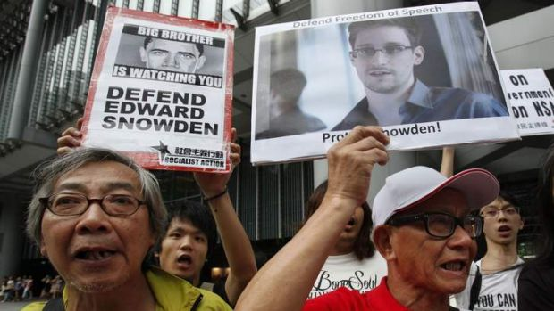 Political asylum: Supporters of Edward Snowden march to the US Consulate in Hong Kong.