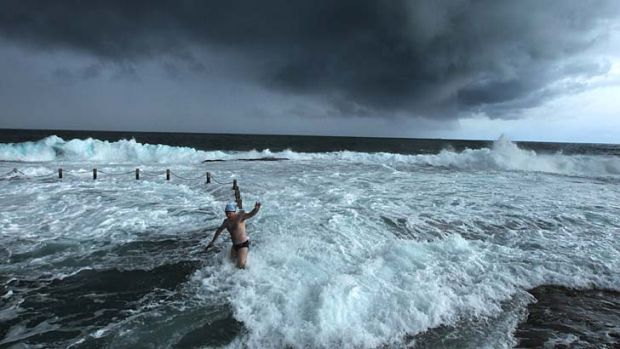 Maroubra Seals winter swimming club members brave the wild weather at Mahon pool.