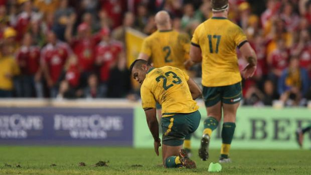 Unlucky: Kurtley Beale  looks back after slipping taking a penalty.