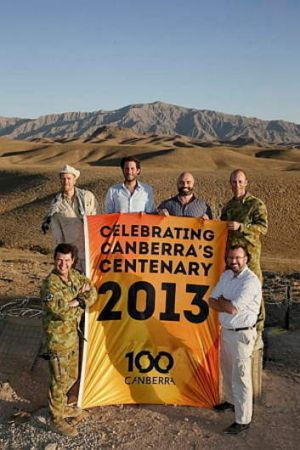 BANNER MOMENT: Unfurling the Canberra centenary flag, from left – back row, DFAT's Fred Smith, AusAid's Steve Burns and ...