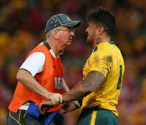 Digby Ioane of the Wallabies receives attention during the first Test.