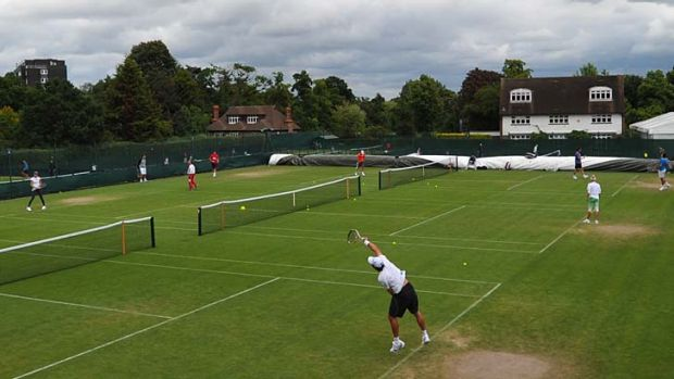 Players practice at the All England Club in Wimbledon, southwest London, on Sunday.