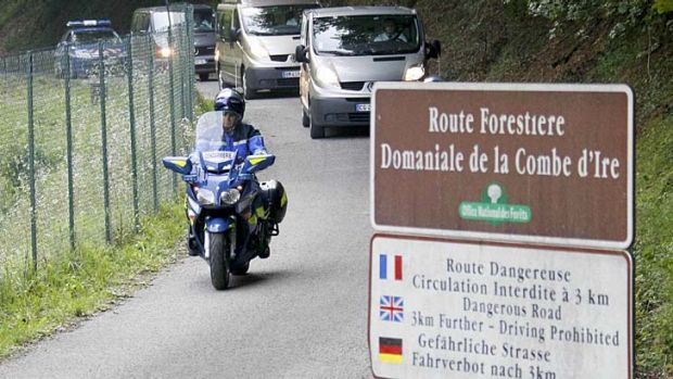 Tragedy: French gendarmes escort hearses from the scene last September.