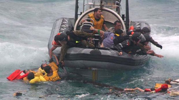 Lost at sea: A photo from the Coroner's report shows asylum seekers being rescued off Christmas Island in December 2010.