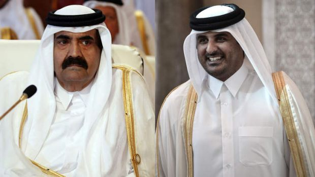 Qatar's Emir Hamad bin Khalifa al-Thani attending the opening of the Arab League summit in the Qatari capital Doha, and ...
