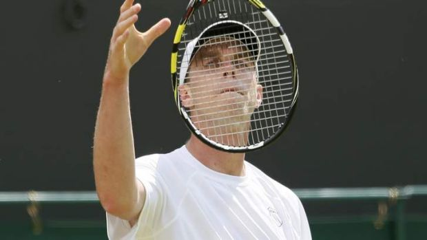 Sam Querrey of the US throws his racquet in the air.