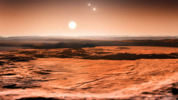 An artist's impression of the view from the exoplanet Gliese 667CD looking towards the planet's parent star (Gliese ...