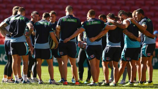 Behind enemy lines: The Blues huddle up on Suncorp Stadium, where they will tonight attempt to end seven years of ...