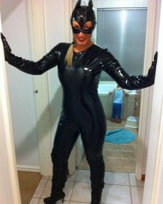MEOW! (But Catwoman really should help that little fella find that toilet step...)