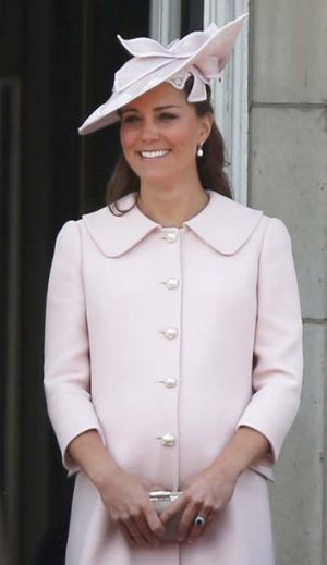 Mother-to-be: Kate, Duchess of Cambridge watch the Guards march past outside Buckingham Palace, during the Trooping The ...