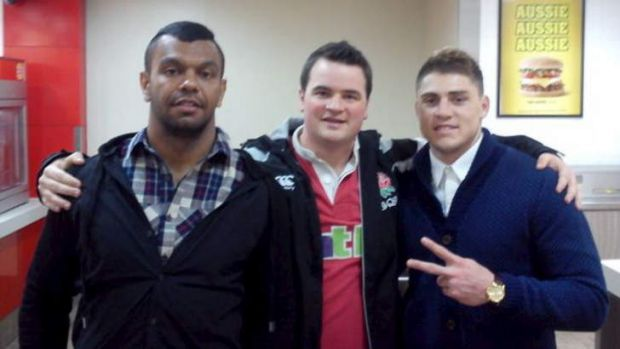 Hunger pains: Kurtley Beale and Hames O'Connor with a fan at Hungry Jack?s in the early hours of Wednesday morning.