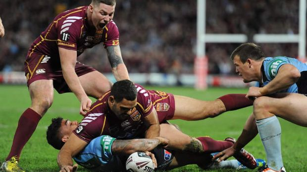 Get square: Greg Inglis played a key role for the Maroons.