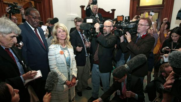 State Senator Wendy Davis is surrounded by media after the Democrats defeated the anti-abortion bill SB5, which was up ...