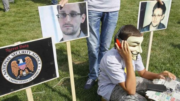 Listening posts: Activists rally in support of Edward Snowden in front of the US embassy in Kiev.