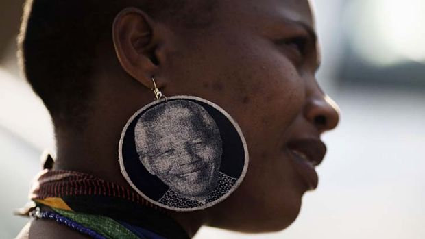 A South African women waits outside the hospital in Pretoria where Nelson Mandela is being treated.