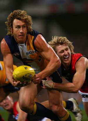 On the run: West Coast'sMatt Priddis looks for support.