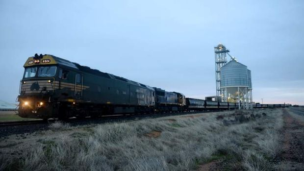 The grain train takes its immense cargo of wheat from Piangil in northern Victoria to the Port of Melbourne. Photos: Pat ...
