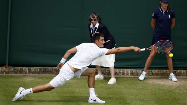 At a stretch: Bernard Tomic served well, returned even better and hit nearly as many cold winners as James Blake in a ...