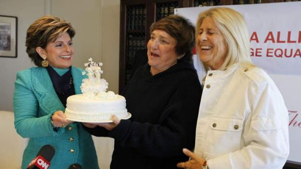 Icing on the cake: Diane Olson, right, and her wife Robin Tyler receive a wedding cake from attorney Gloria Allred at a ...