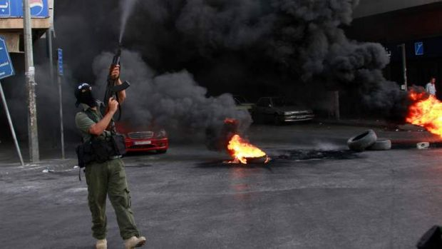 Dark days: Rising Sunni Islamist militancy in Lebanon, seen here during a protest in Tripoli, has H Photo: Reuters
