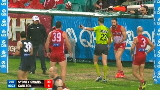 Nick Malceski looks on in disbelief as an umpire awards a free kick to Carlton for a deliberate rushed behind.