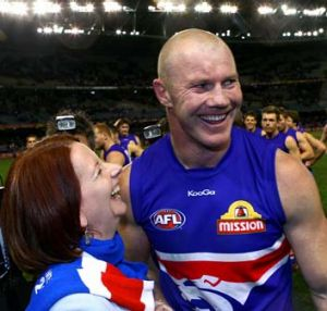 Bulldogs forward Barry Hall and Julia Gillard celebrate after the Dogs defeated North Melbourne at Etihad Stadium on ...