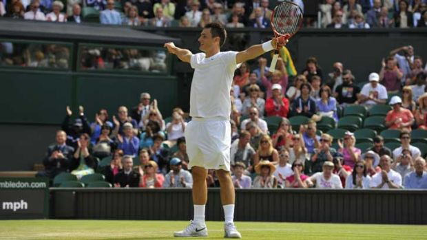 Australia's Bernard Tomic celebrates beating France's Richard Gasquet in the third round.