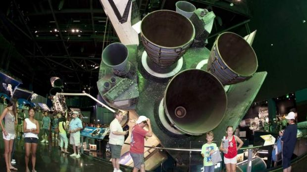 Flight simulation: Visitors view the space shuttle Atlantis on the opening day of its exhibit at the Kennedy Space ...