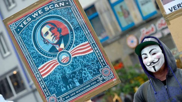 Under surveillance: A demonstrator protests in the German city of Hanover amid reports the US bugged European Union offices.