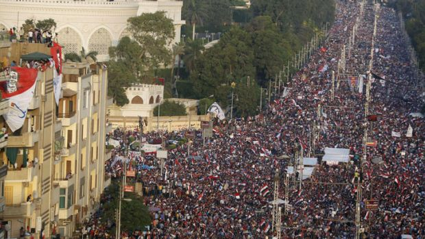 Protesters opposing Egyptian President Mohamed Morsi fill the streets in front of El-Thadiya presidential palace in ...