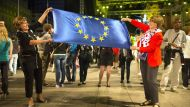 Two women hold a European Union (EU) flag during celebrations in Ban Jelacic square as Croatia marks it's entry into the ...