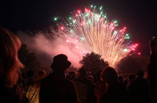 People gather to watch the fireworks display launched above the stone circle at the Glastonbury festival.