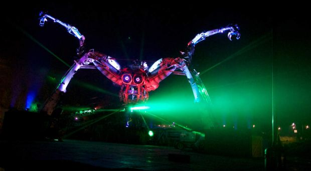 A mechanical spider moves around the site on the first night of the Glastonbury festival.