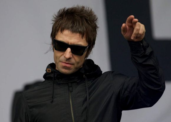 British singer Liam Gallagher gestures to the crowd while performing with his band Beady Eye.