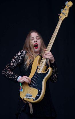 American singer and bass player Este Haim performs in the band Haim on the Pyramid Stage.