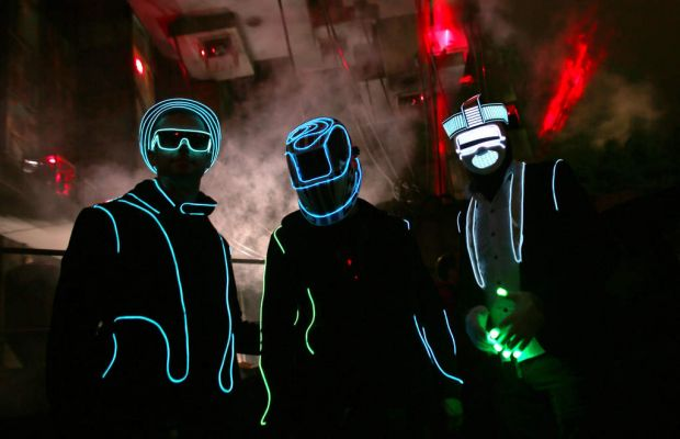 People dance outside a nightime venue in the Block 9 area at the Glastonbury festival.
