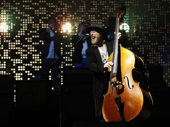 Bassist Ted Dwane of Mumford & Sons performs at the Glastonbury music festival.