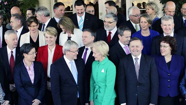 Prime Minister Kevin Rudd, surrounded by his new ministry, talks to Governor-General Quentin Bryce.