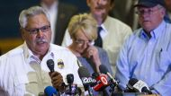 Chief Dan Fraijo, speaks as  Gov. Jan Brewer wipes away a tear during a news conference at Prescott High School, Monday, ...