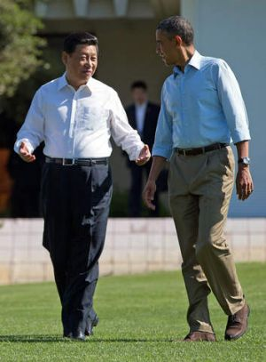 President Barack Obama and Chinese President Xi Jinping walk at the Annenberg Retreat of the Sunnylands estate Saturday, ...