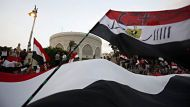 Protesters opposing Egyptian President Mohamed Mursi wave Egyptian flags and shout slogans against Mursi and members of ...