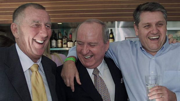 It's good to be the kings ... John Singleton, Alan Jones and Ray Hadley celebrate at a bar in Darling Harbour.