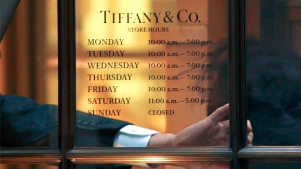 An employee arrives for work at theTiffany & Co. store on Wall St. in New York's financial district.