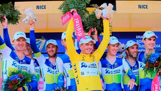 Simon Gerrans of Australia and Team Orica-GreenEDGE celebrates Gerrans' overall leader yellow jersey on the podium at ...