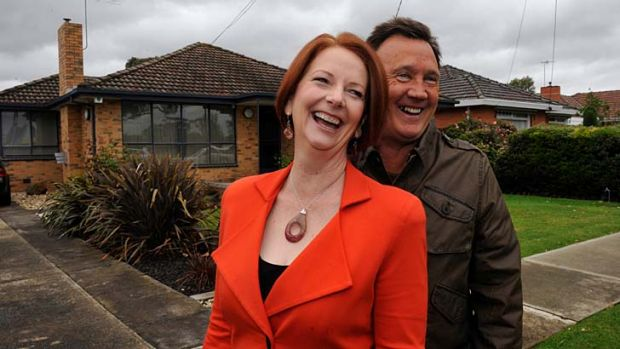 Former prime minster Julia Gillard, pictured with partner Tim Mathieson outside their home in Altona, has paid tribute ...