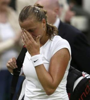 Petra Kvitova of the Czech Republic walks off the court after being defeated.