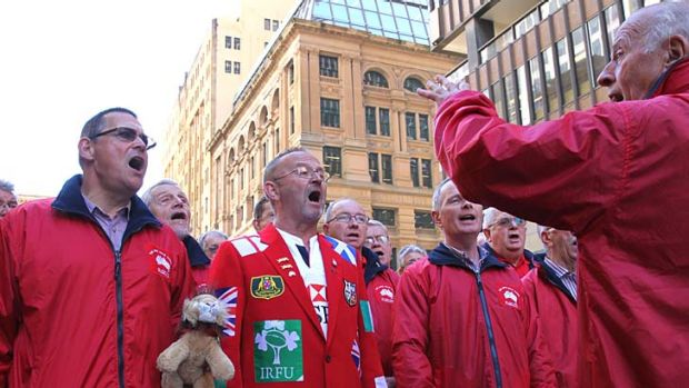 The Lions choir performs in Martin Place on Wednesday prior to the Lions final decider game on Saturday.